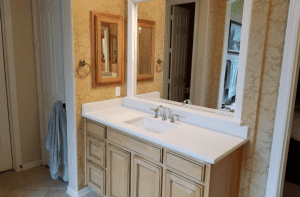 Custom Bathroom Counters - clean white quartz custom bathroom counters