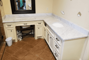 Custom Bathroom Counters - custom fit light granite bathroom countertop installation
