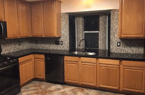 Custom kitchen counters - showing off custom back splash and custom granite countertops