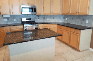 Custom kitchen counters - showing off custom back splash with custom granite counters