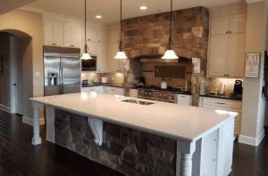 Custom kitchen counters - beautiful custom kitchen with stone accents and custom stone counters